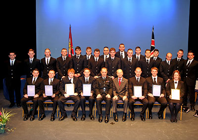All the recuits pictured on stage in formal undress uniform in two rows