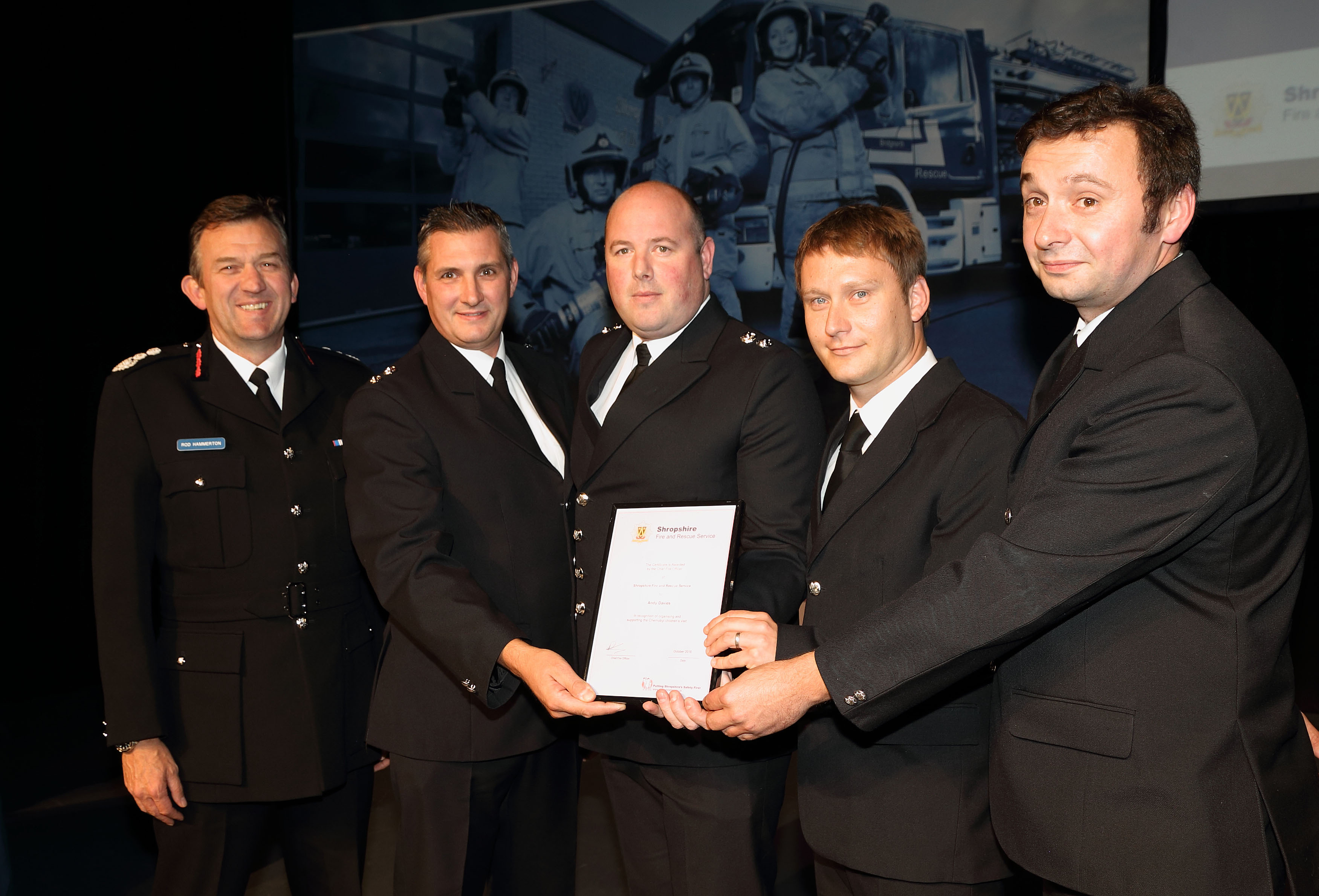 Blue Watch Shrewsbury received an award for their work with children from Chernobyl. Pictured with Chief Fire Officer Rod Hammerton are, left to right, Paul Gray, Richard Meadows, Andy Davies and Graham Carless.