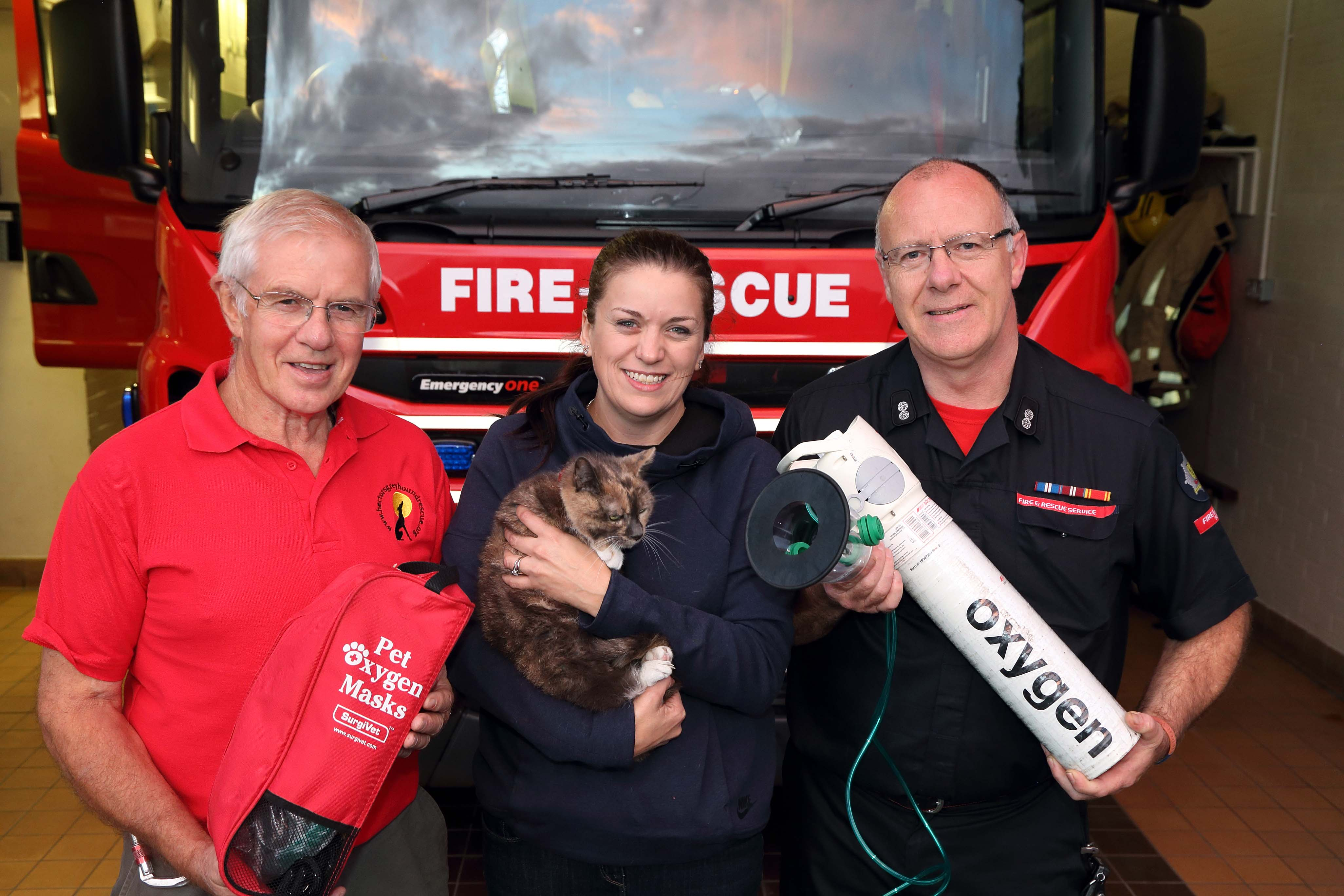Fundraiser Fred Brown, pet owner Shelley Hall and Watch Manager Steve Moorhouse Harriet the cat at Ellesmere Fire Station. Harriet is the first animal in Shropshire to be revived with the new pet oxygen mask after a house fire