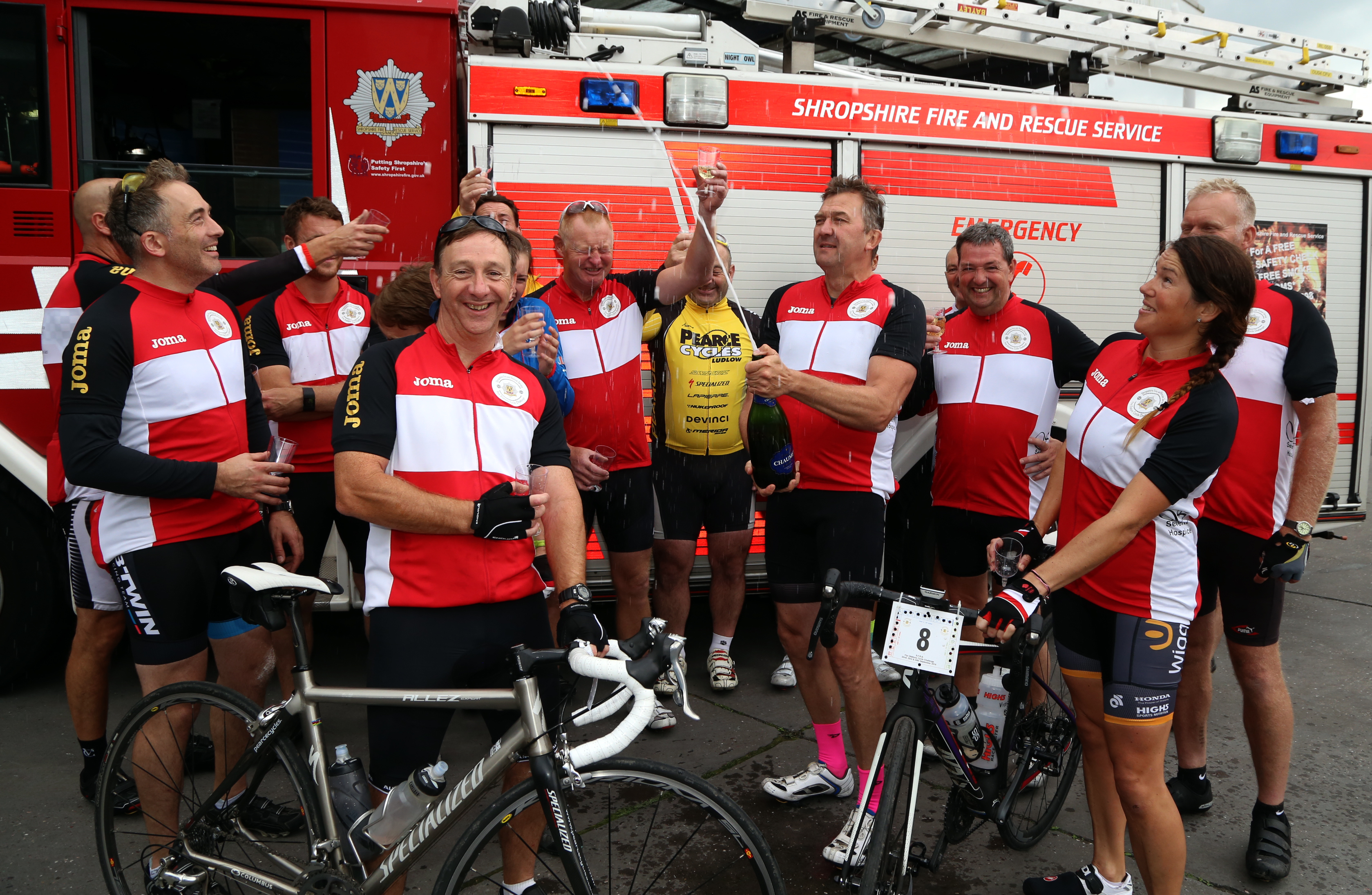 Champagne corks popped at the end of a marathon three day charity cycle ride in aid of The Severn Hospice and the Fire Fighters Charity by members of Shropshire Fire and Rescue Service.