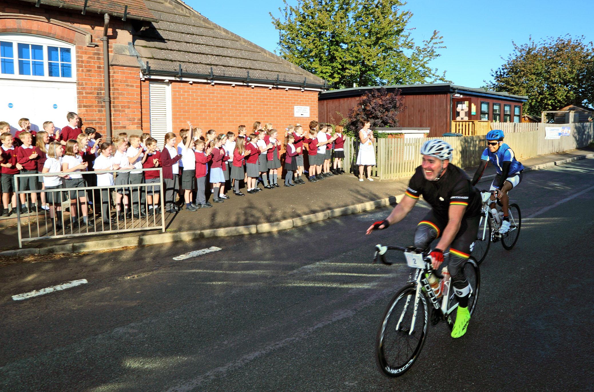 Primary schoolchildren from Condover School cheer cyclists en route