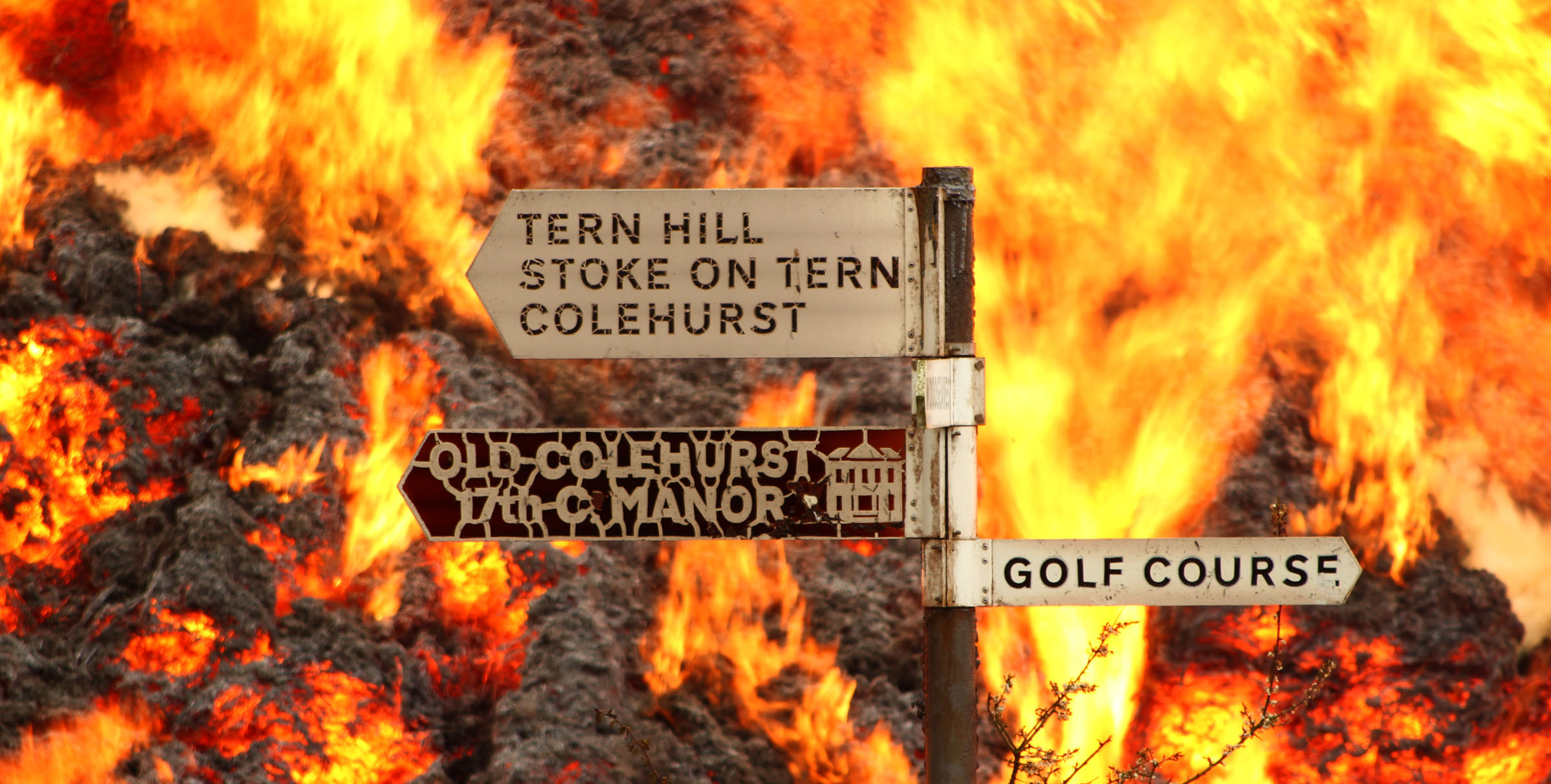 The fierce fire fought by firefighters even melted road signs