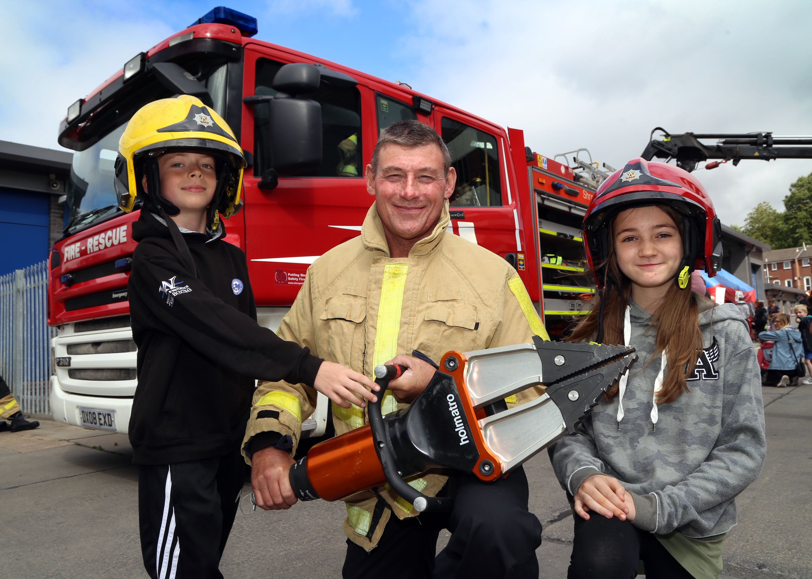 Firefighter Chris Davey shows Joe Sheridan (9) and Tabitha Bridgman (12) the special cutters used to rescue people from road traffic collisions.