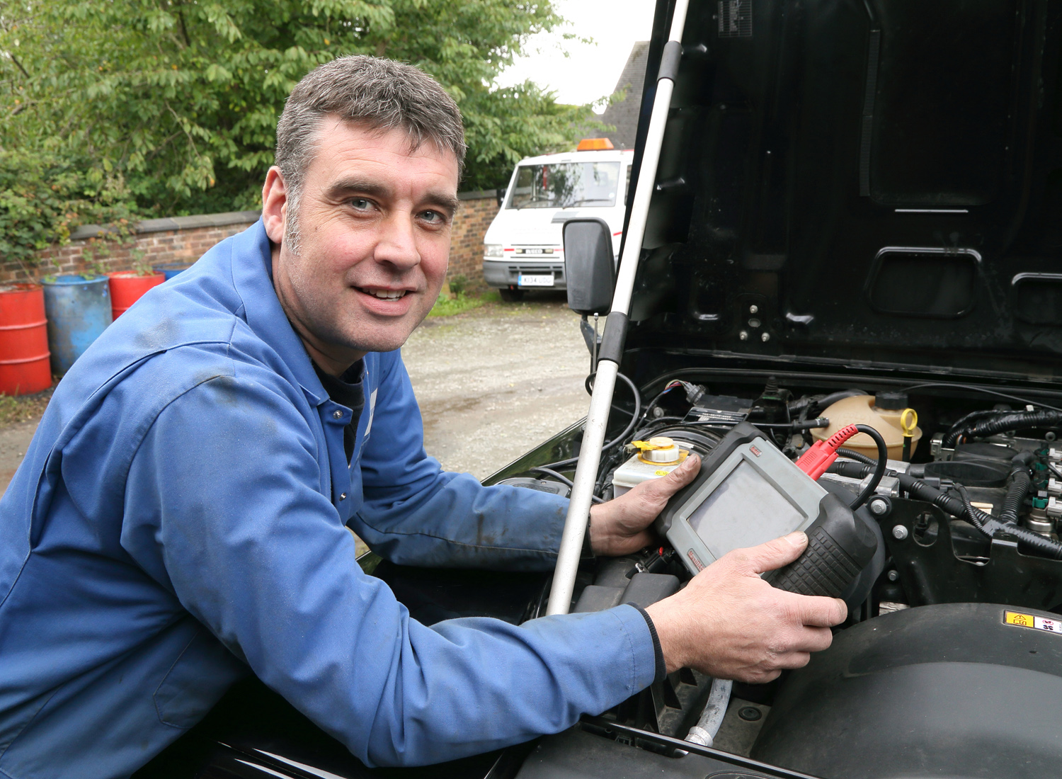 On call firefighter Jeremy Chambers (44), a mechanic at Prees Auto, has dyslexia and Meares Irlen syndrome and is now getting filtered glasses to make reading easier.
