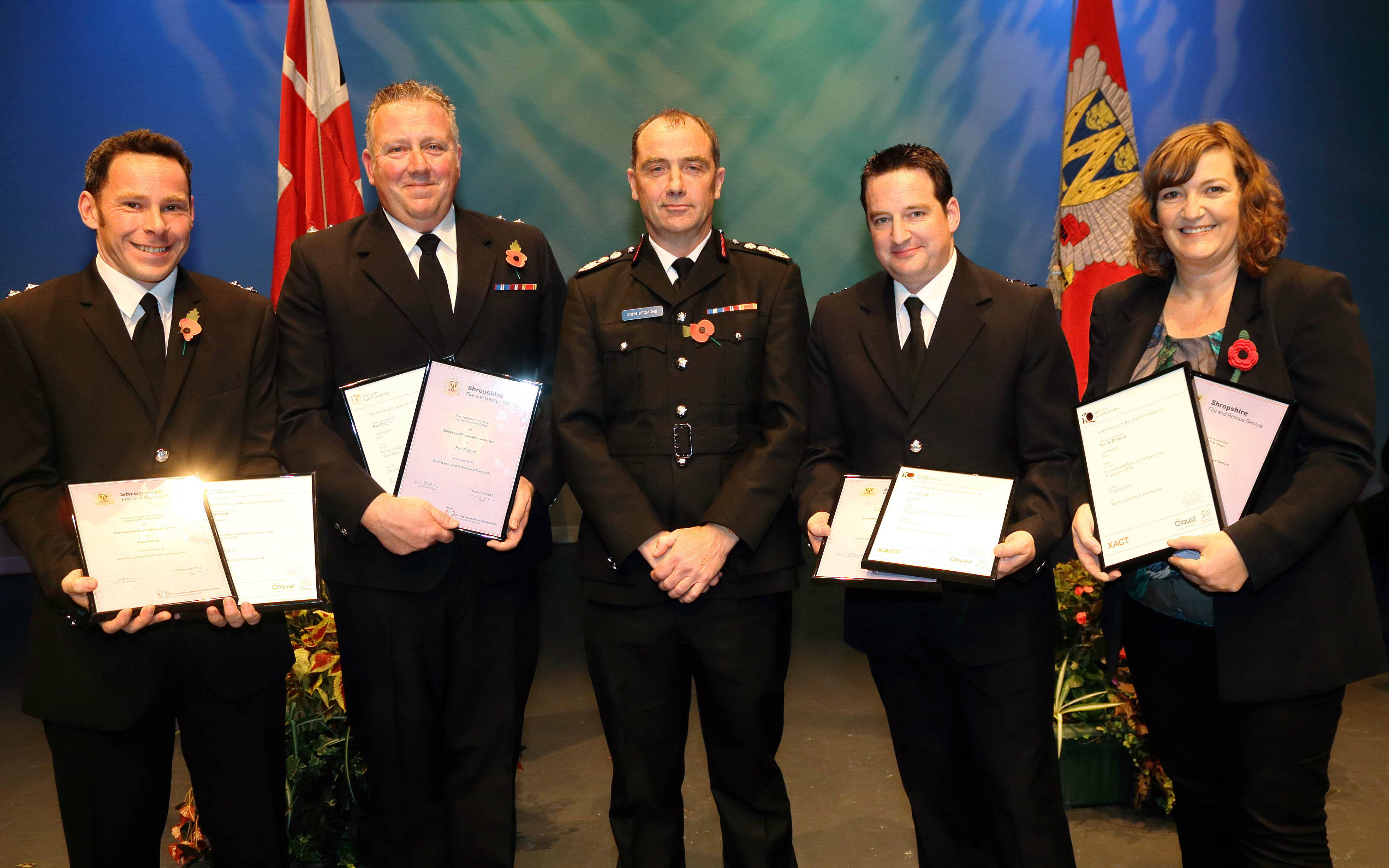 Paul Smith, Paul Fulgoni, Ceri Flavell, and Louise Derricutt, receive their awards.  Lynn Walker was unavailable to attend.