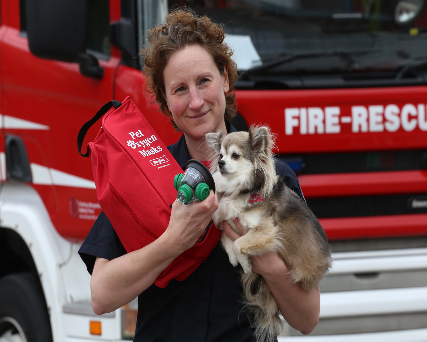 Firefighter Louise Fletcher with the pet oxygen mask