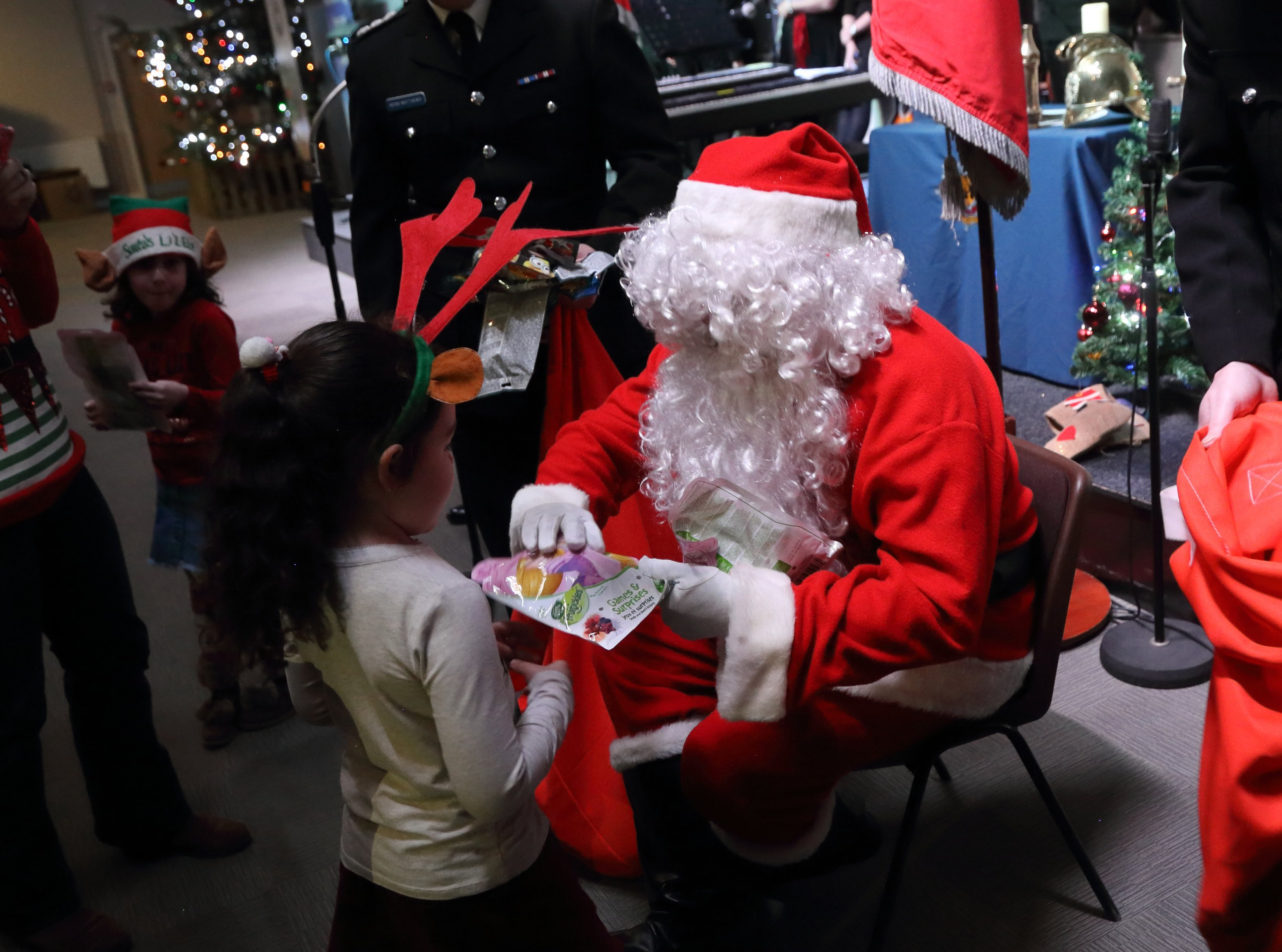 Father Christmas hands out presents