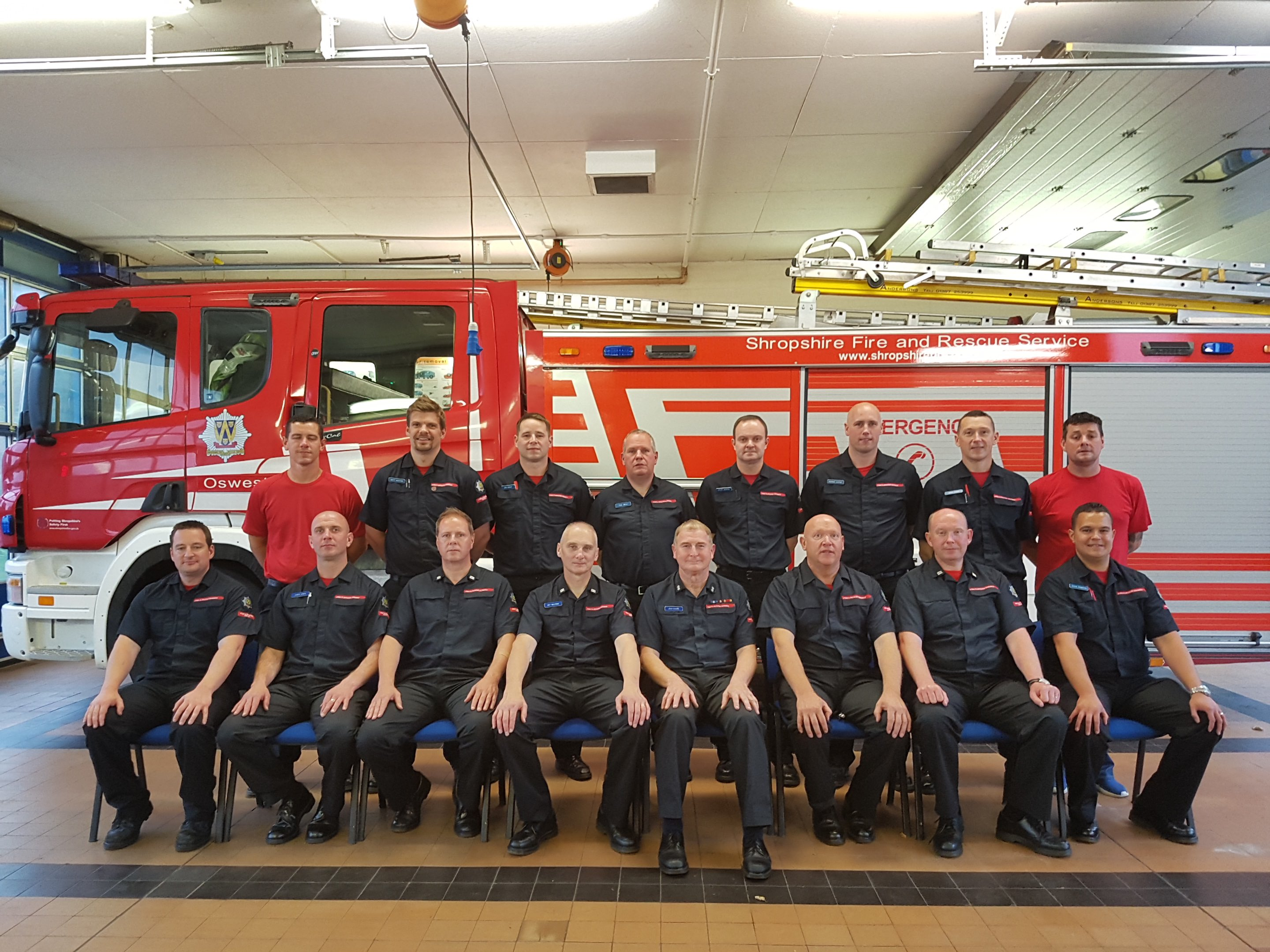 Oswestry Watch Manager John Davies (fourth from right front row) retires after a 33 year career as an on call firefighter. PIctured with the Oswestry crew.
