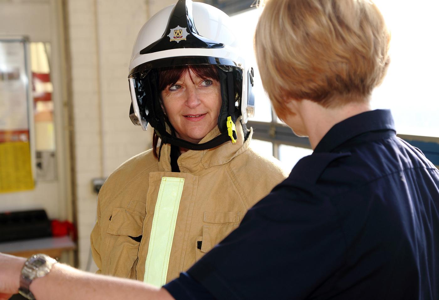 Oswestry's Liz Killvert listens to firefighter Ruth Walkerdine.