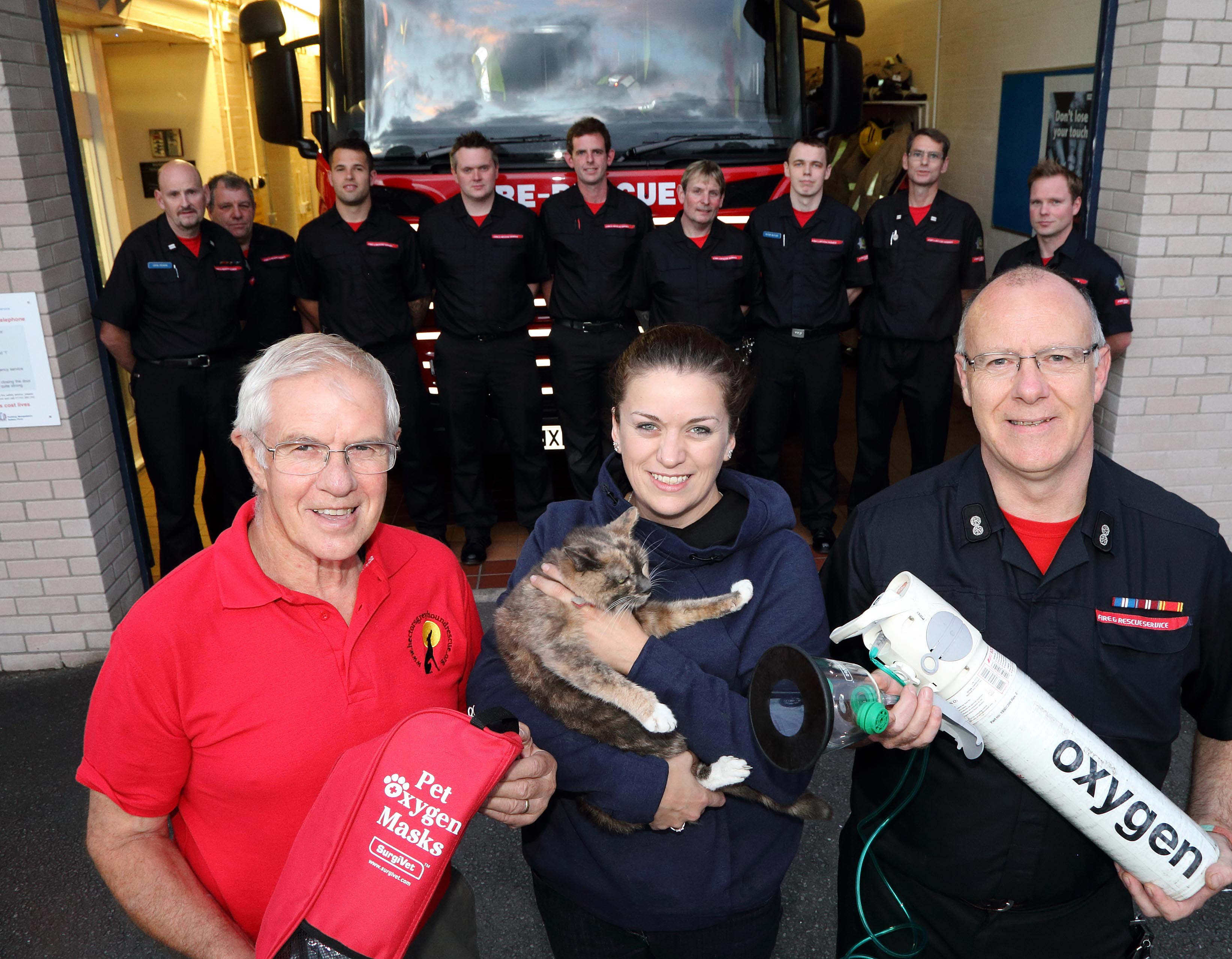 Ellesmere firefighters with fundraiser Fred Brown, pet owner Shelley Hall and Watch Manager Steve Moorhouse and Harriet the cat at Ellesmere Fire Station. Harriet is the first animal in Shropshire to be revived with the new pet oxygen mask after a house fire