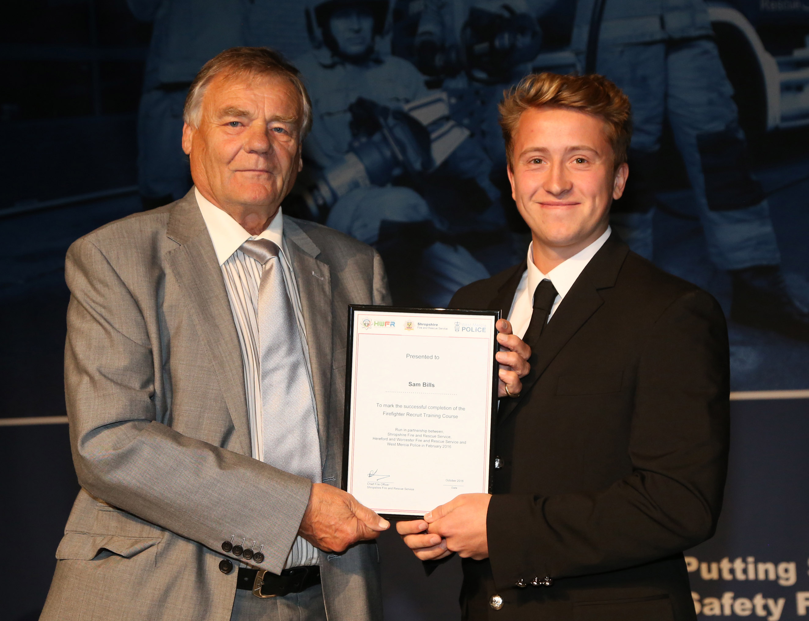 Delivery driver Sam Bills, from Cleobury Mortimer, won the top student award for his course as did Zoe Morgan, from Craven Arms, pictured with Watch Manager Matt Angell.