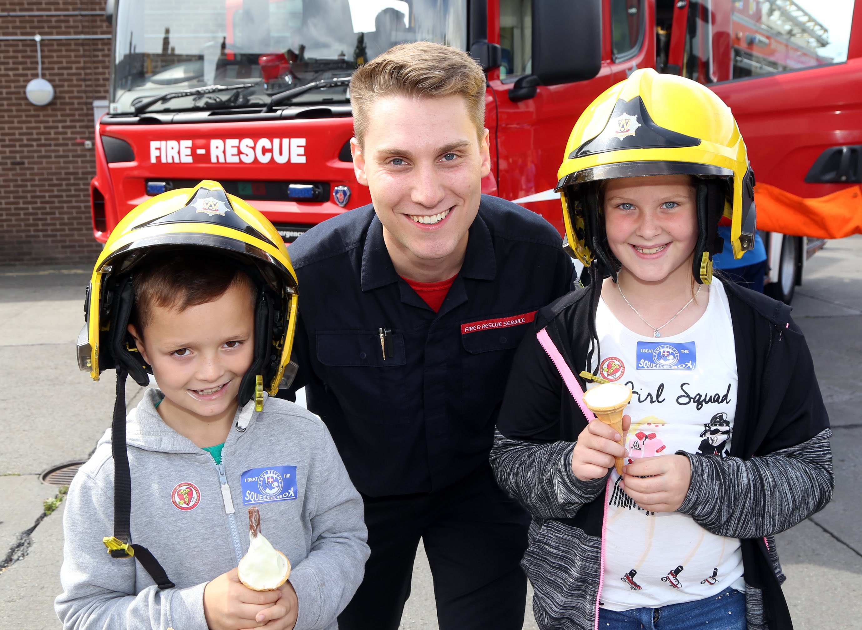 Wellington firefighter Louie Longhi with Freddie Treherne (9) and Lily Mae-Bailey (8), both from Shrewsbury.