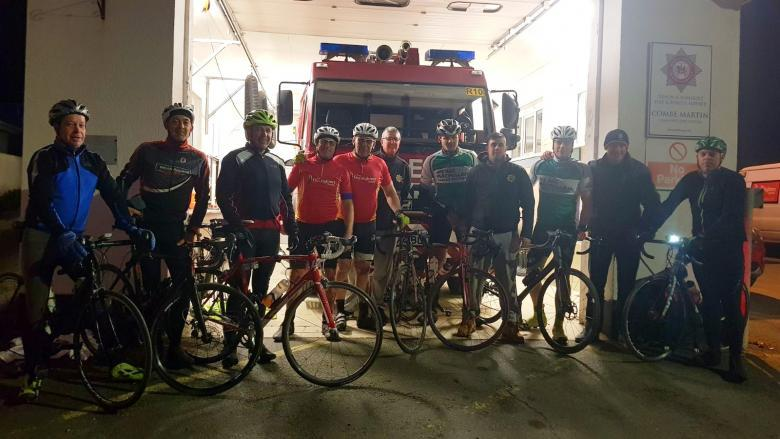 Tired but victorious after the marathon cycle ride at Devon's Combe Martin Fire Station with local cyclists.