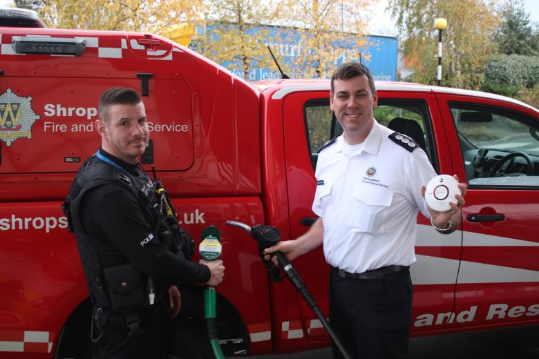 Station Manager James Bainbridge and PC Richard Bramwell in the joint fire and police safety campaign as part of Road Safety Week 2017