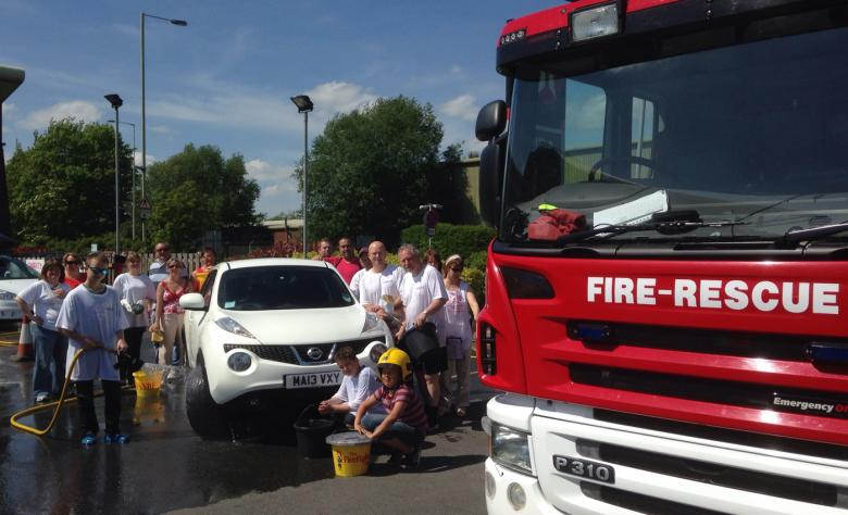 Shropshire firefighters join charity fundraisers in a Ludlow car wash