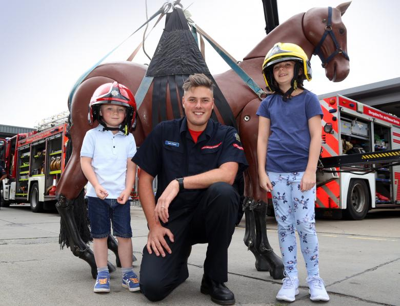 At Shrewsbury Fire Station's annual 2018 open day is firefighter Sam Dawes with Benjamin (6) and Hannah Bradley (10) with Bullseye, a replica horse used to train firefighters in animal rescues.