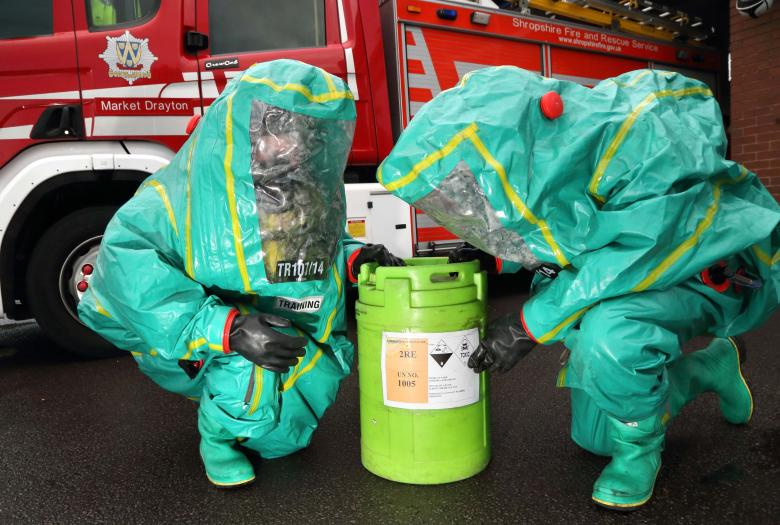 Market Drayton firefighters wear protective suits to train for a chemical leak at a weekly drill night