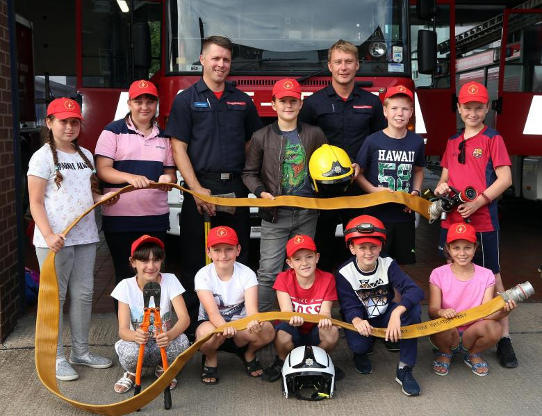 Chernobyl children had fun at Shrewsbury fire station. Pictured with firefighters James Fisher and Andy Davies (right).