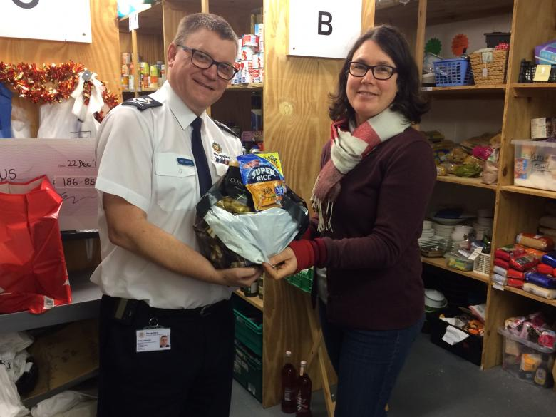 Deputy Chief Fire Officer Andy Johnson and Shrewsbury Food Plus Project Leader Karen Williams with one of the many food parcels being distributed to people in need today.