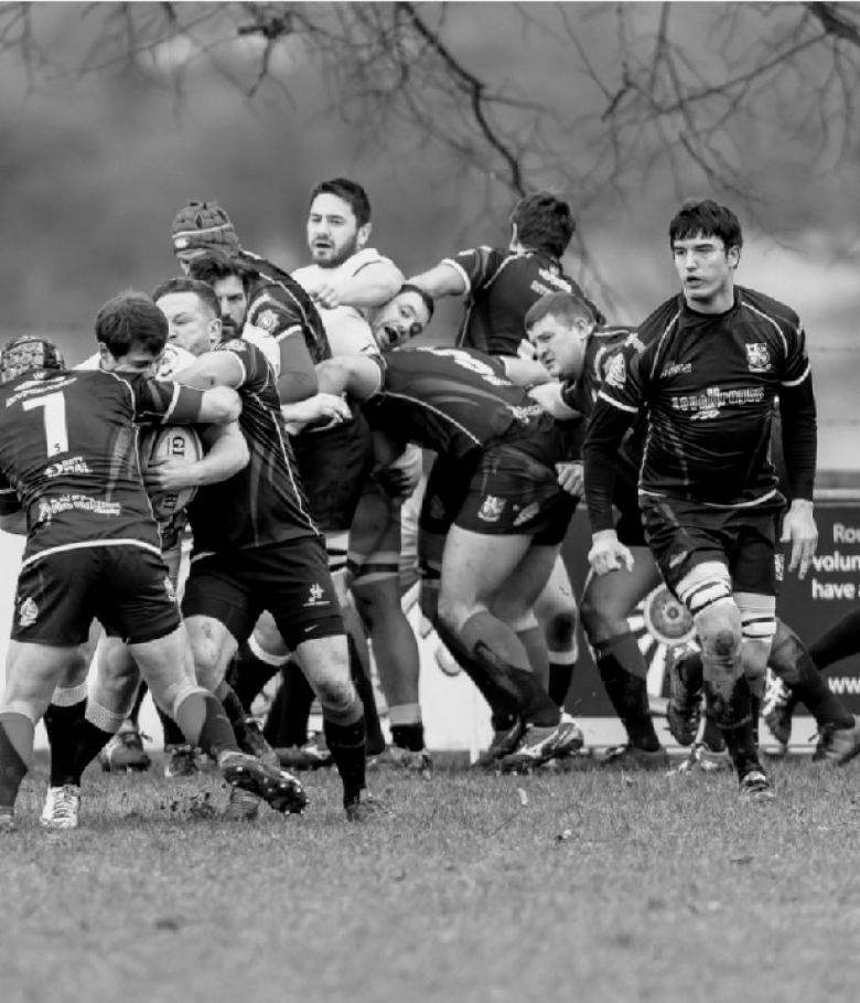 Ludlow firefighter George Jacks (pictured right of rugby scrum) gets ready to win the ball back for the UK Lions fire service team