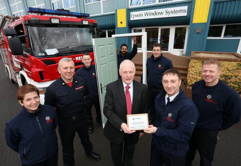Area Manager John Harrison presents a plaque to Sales Director Paul Lindsay to mark their contribution to Shropshire firefighter training with Green Watch. L to r: firefighters Beverley Morris, Crew Manager Ian Pugh, Joe Thompson, Lee Guinea, Adam Tempest and Mitch Thorne.