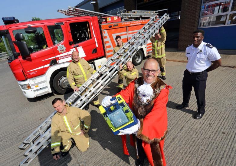 Firefighters from Red Watch Shrewsbury gave a lift to Shrewsbury Mayor's defibrillators for schools appeal with their charity efforts to take a ladder to the top of Snowdon. L to R: Matt Dickenson, Graham Oliver, Lee Roberts, Steve Westley (kneeling), Kent Hallihan and Luke Grant, who all carried the ladder up Snowdon.
