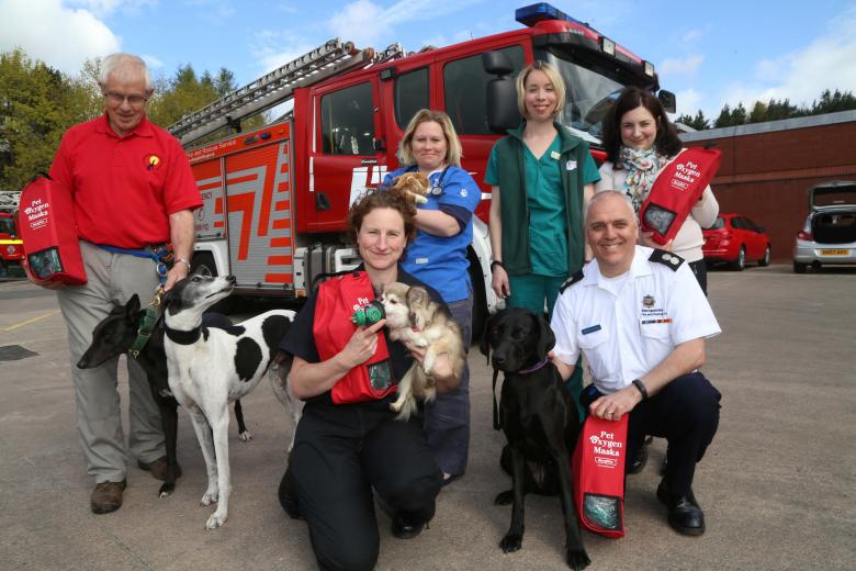 Shropshire pet lovers unite to raise funds for pet oxygen masks for firefighters. Left to right: Fred Brown (Hectors Greyhounds); firefighter Louise Fletcher, Haygate vet Tamsin Learoyd-Hill and vet head nurse Emma Carey with Amy Stewart (Happy Tails Dog Spa) and Watch Manager Martin Huckle (front right)