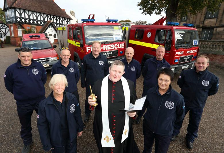 Canon Jonathan Mitchell, the Dean of Shrewsbury Cathedral, blesses the fire engines in a traditional ceremony in Shrewsbury before the trip to Romania. He is pictured with Ann Lewis (left) and Jean Jones with (back row) firefighters Scott Hurfield and John Hammond with Steve Worrall, Shropshire and Wrekin Fire Authority member Councillor Mal Price, Mark Briscoe and Steve Purslow.