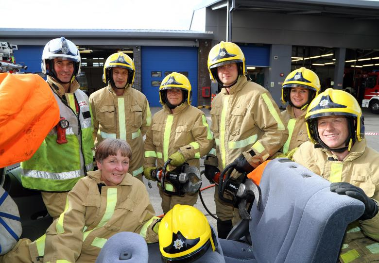 """In the """"hot seat"""" is Shropshire's High Sheriff Christine Holmes (below left) after being cut free from a car by firefighters from Shrewsbury's Green Watch who train regularly to rescue county road crash victims. L to r: Watch Manager Alex Howell with firefighters Geraint Lewis, Bev Morris, Steve Mason, Kate White and Mitch Thorne at Shrewsbury fire HQ."""