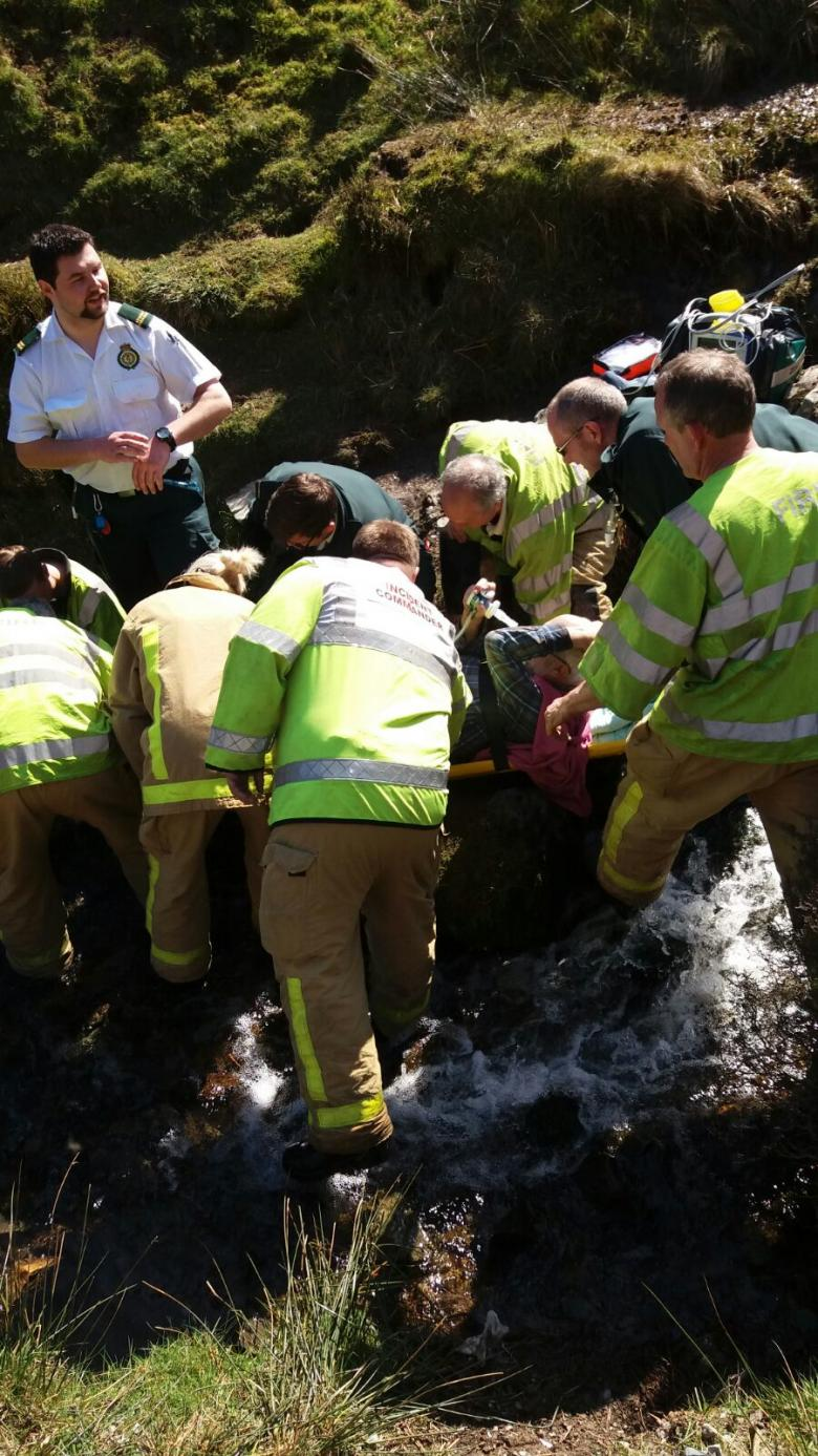 Firefighters and ambulance staff rescue walker Ian Dutton from the Long Mynd.