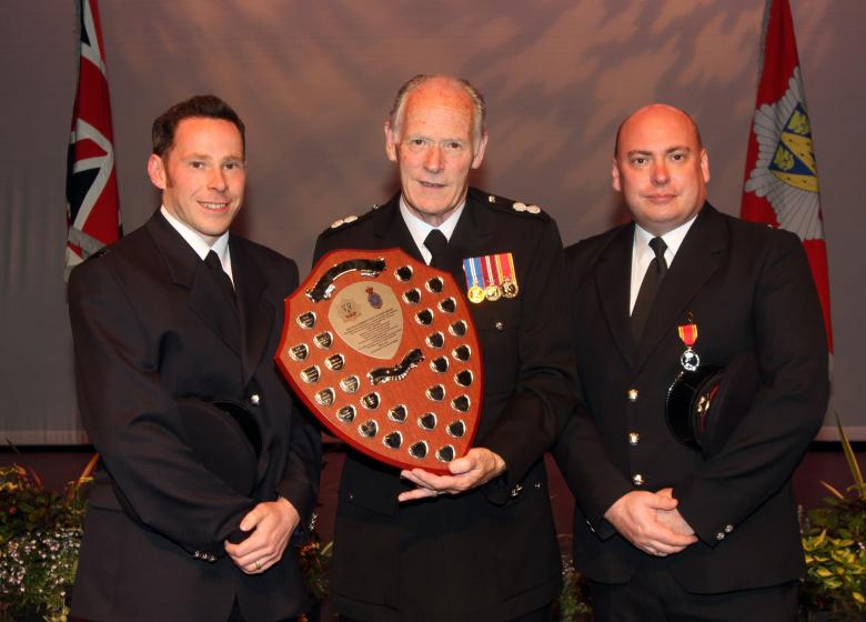Roger Smith with sons either side receives High Sheriff shield