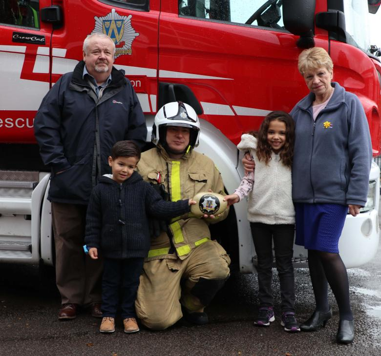 Sophia and Saul Moody at Market Drayton Fire Station with Watch Manager Mark Smith and grandparents Dale and Lin Moody