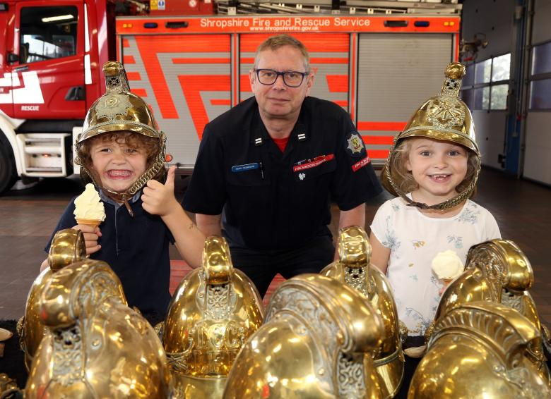 A definite thumbs up and widest possible grin from Riley Al Sadek (5) with sister Ruby Mai (7), from Shrewsbury, with Whitchurch firefighter Keith Robinson.