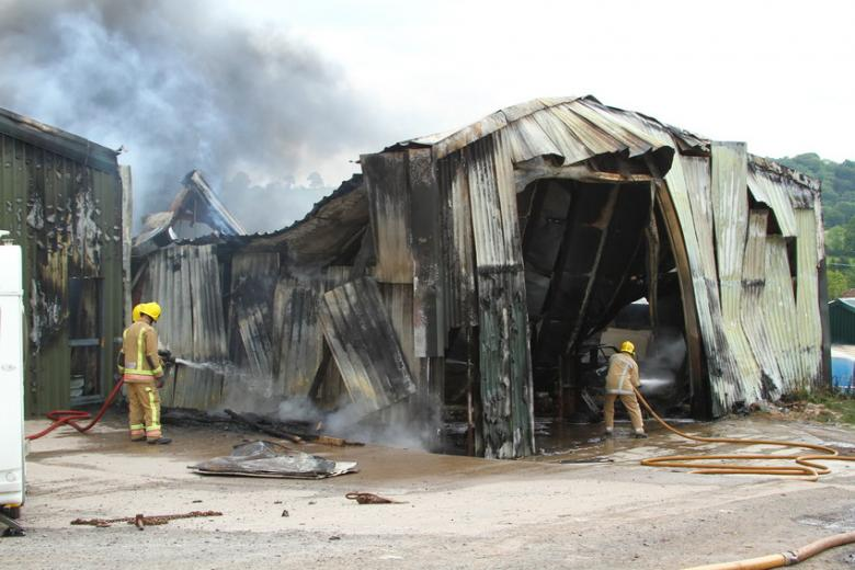 photo of badly damaged barn